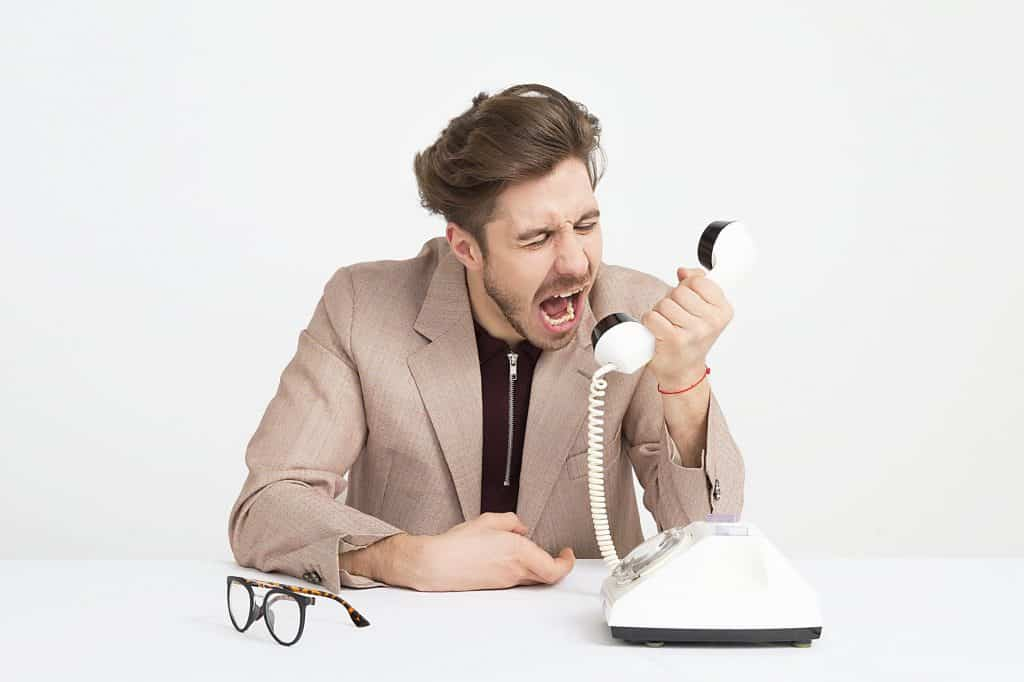 Man shouting at phone
