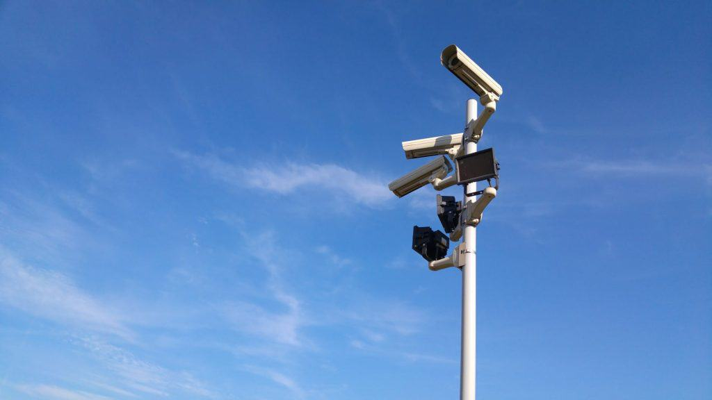 Security surveillance cameras on a pole