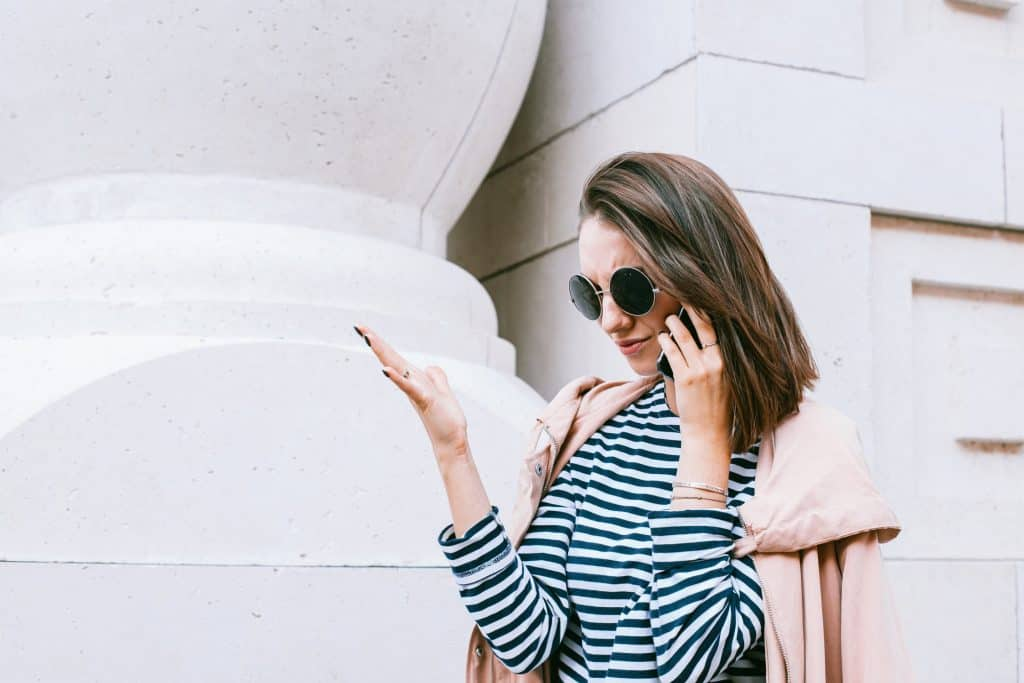 A young trendy woman on the phone