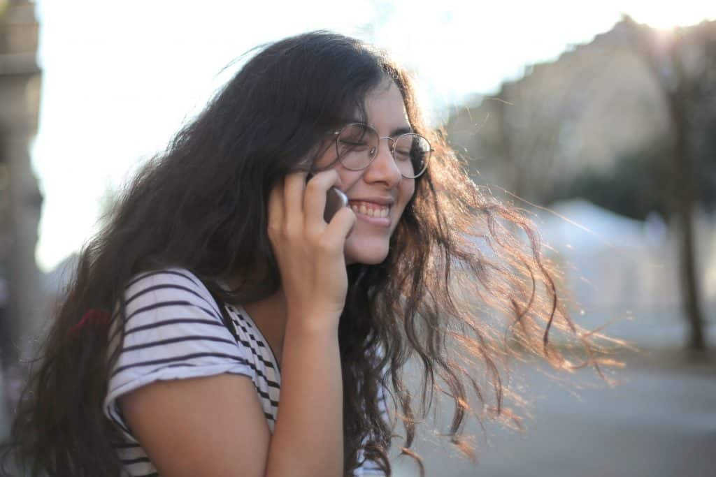 A girl laughing on the phone