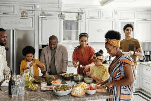 A family preparing dinner together in the kitchen