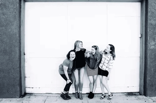 A group of girlfriends posing in a black and white photograph