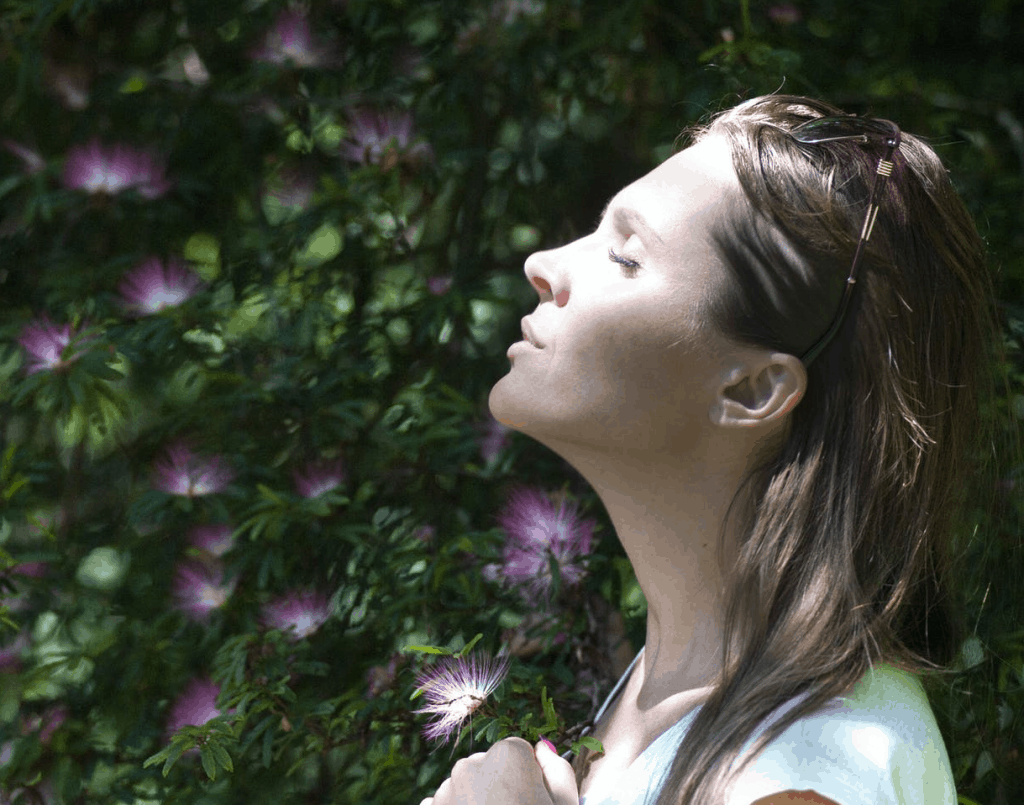 A woman breathing in the fresh nature air