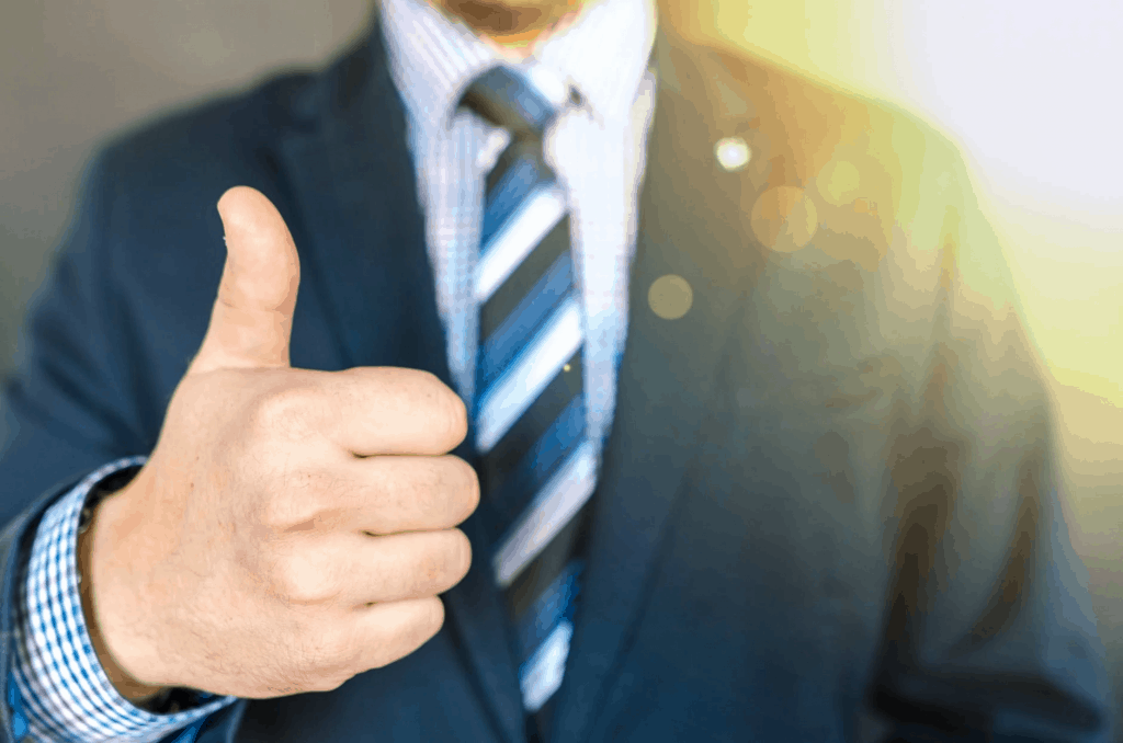 A businessman with his thumbs up