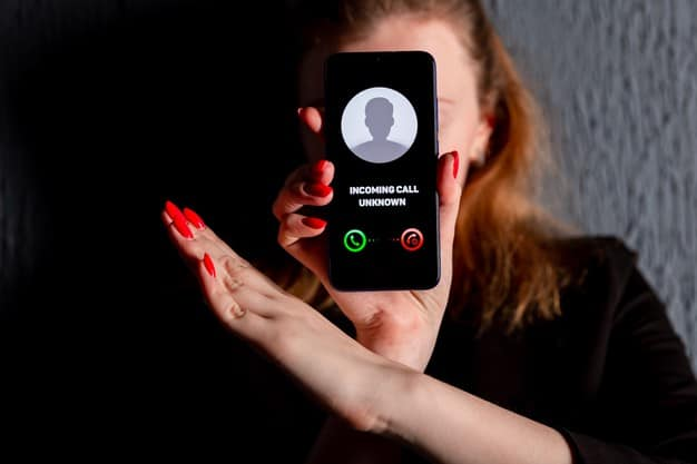 A woman holding a phone with no Caller ID