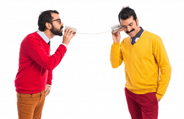 Twin brothers communicating with each other through tin cans
