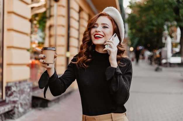 A young trendy woman speaking on the phone
